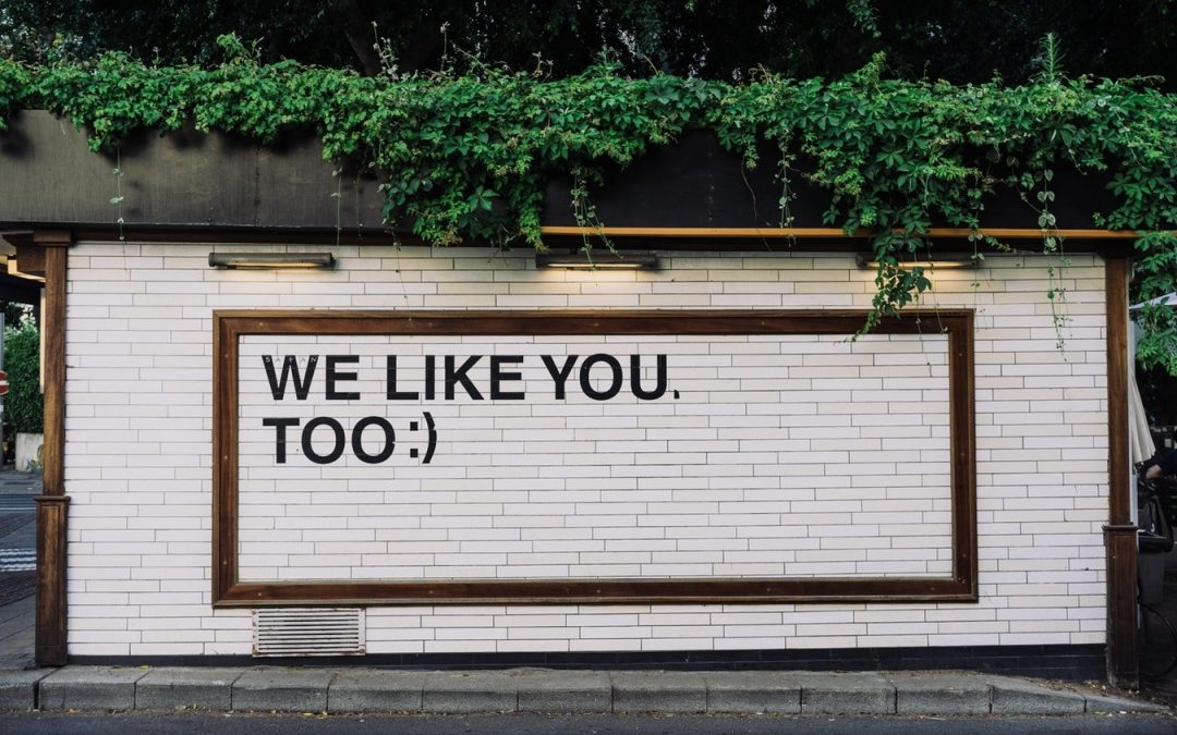 we like you too text painted on wall