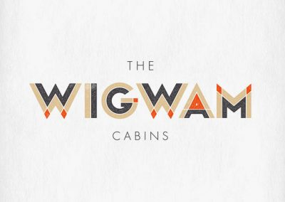 the wigwam cabins logo